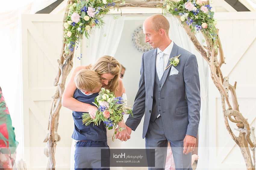 Beach Weddings Bournemouth Bride hugs her son