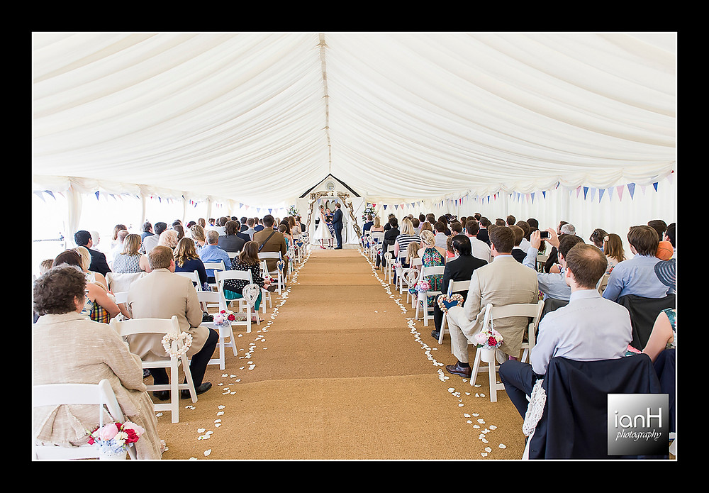 Beach Weddings Bournemouth - Sarah & Andy - marquee filled with guests