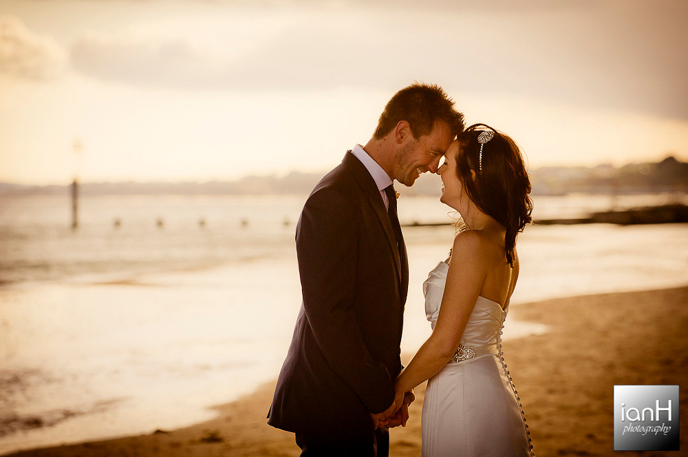bournemouth-beach-weddings-bride-and-groom-on-Boscombe-beach-with-the-setting-sun
