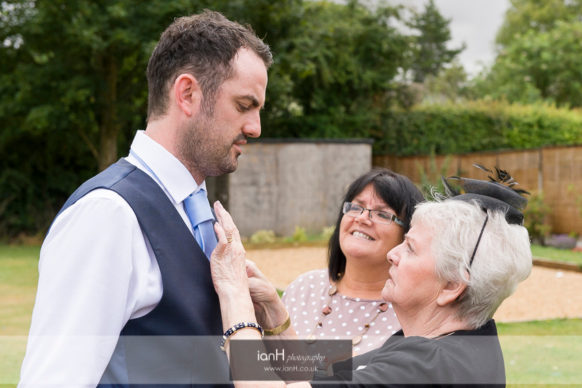 Groom's buttonhole being adjusted