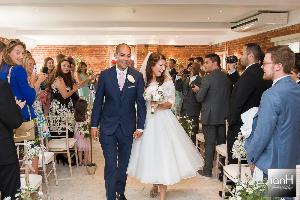 Down the aisle at Sopley Mill Summer wedding