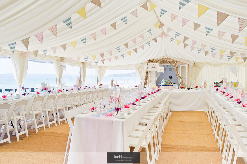 Rows of tables at beach wedding reception