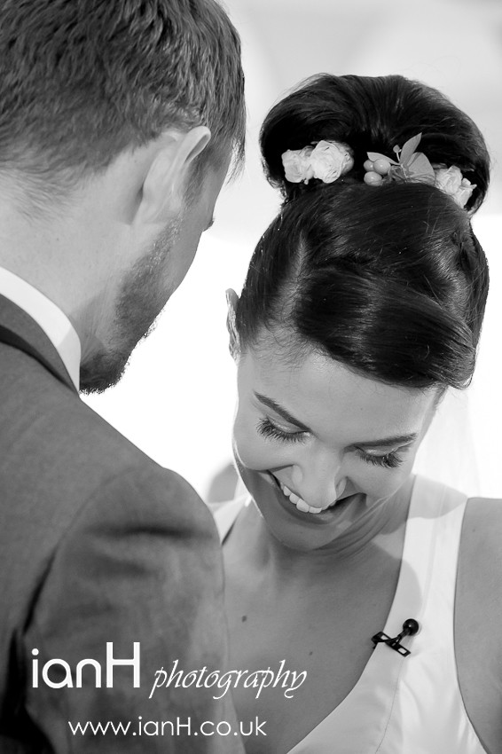 Bride and Groom smiling after their exchange of wedding vows on Bournemouth beach - Dorset wedding photographer