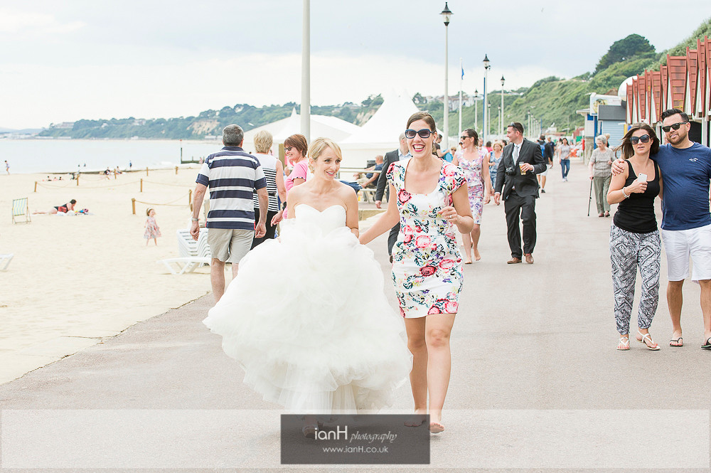 Bride walking along Bournemouth promenade