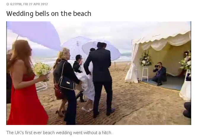 Dorset wedding photographer caught on film by Meridian TV as he shoots the first beach wedding in Bournemouth