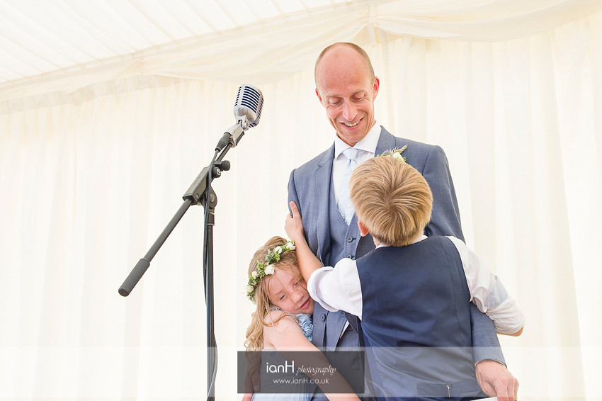 Bournemouth beach wedding Groom being hugged by his children