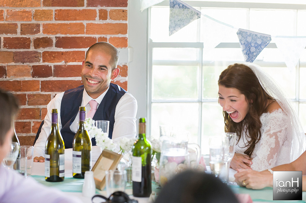 Laughter during speeches at Sopley Mill wedding