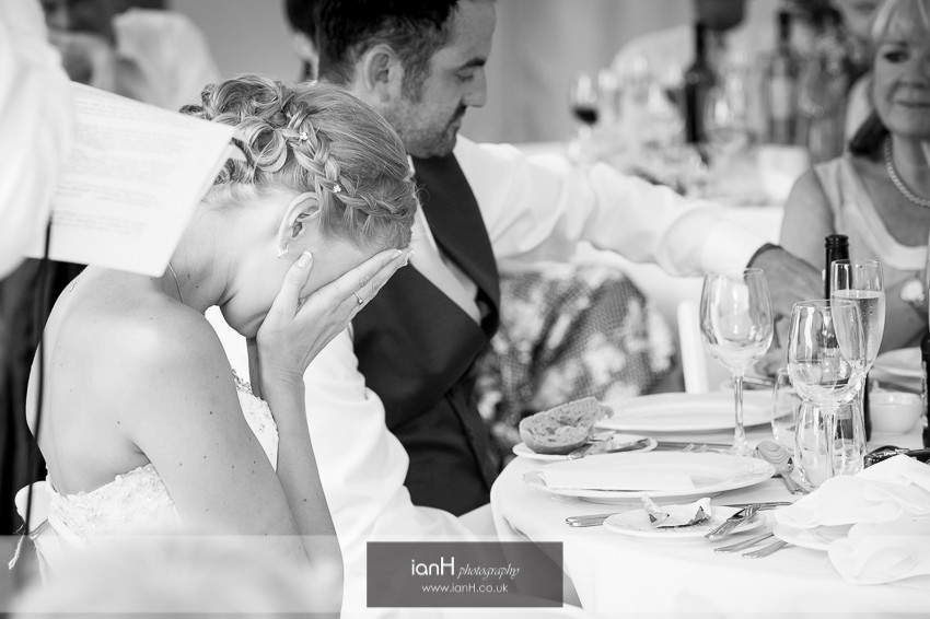 Bride holds her head in her hands - speech
