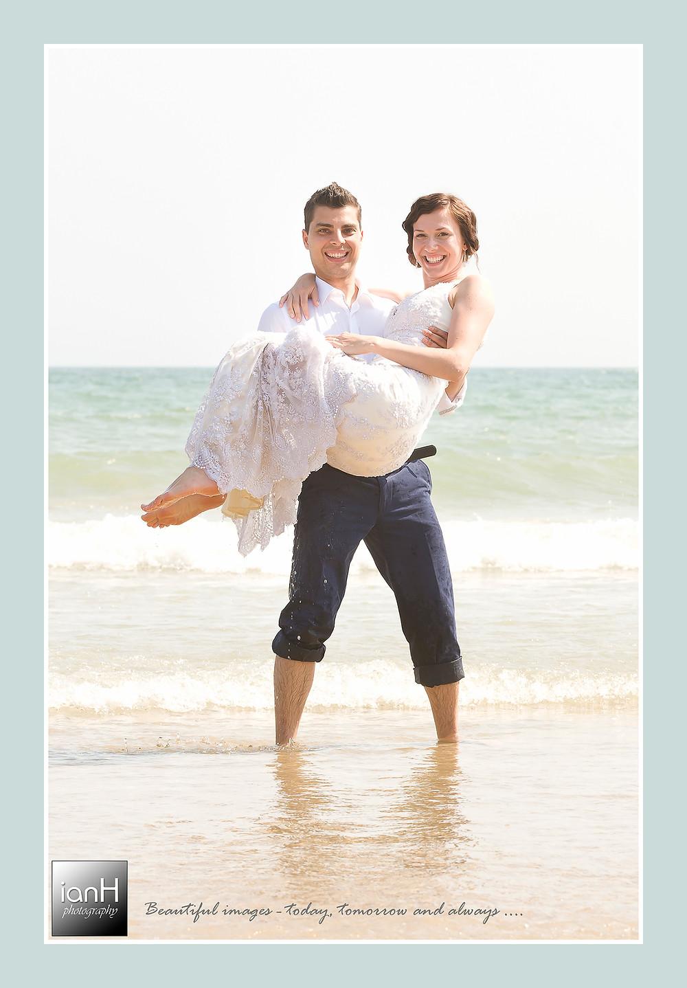 Beach Weddings Bournemouth anniversary - Anna and Daniel in the sea