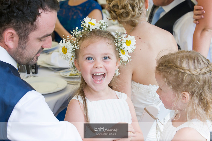 Smiling flowergirl at Hampshire wedding