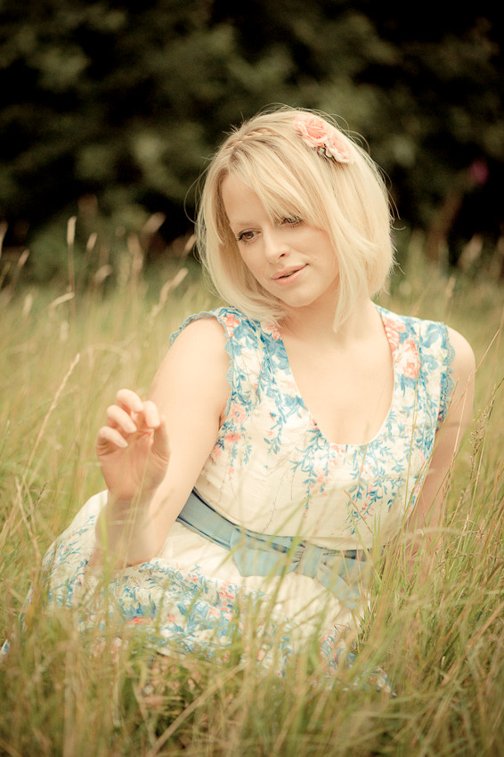 Blonde girl in the long grass