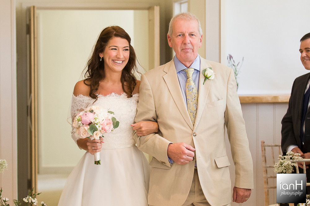 Bride and Father walk down the aisle at Sopley Mill