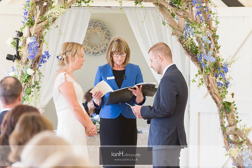 Exchange of wedding vows at Bournemouth beach wedding