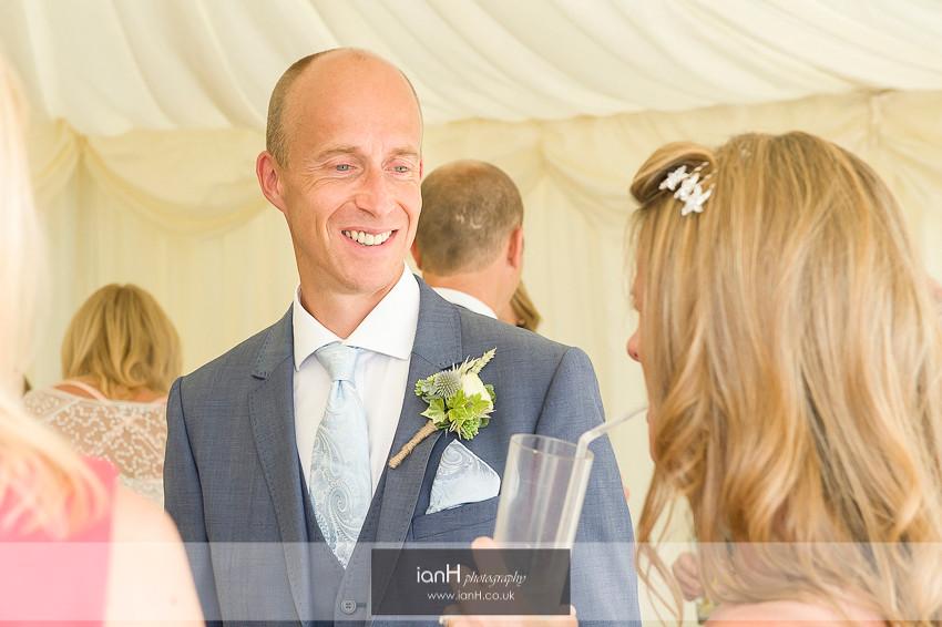 Beach Groom smiles at his Bride