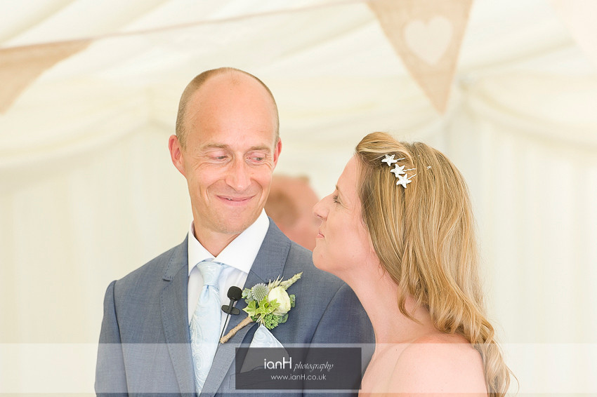 Smiling Bride and Groom at their Bournemouth beach wedding ceremony
