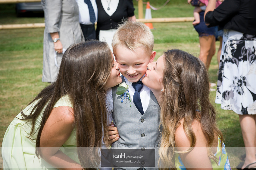PageBoy gets a kiss from his Sisters after the wedding in Hampshire