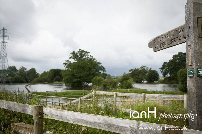 Signpost_across_flooded_fields_near_Bournemouth_in_Dorset