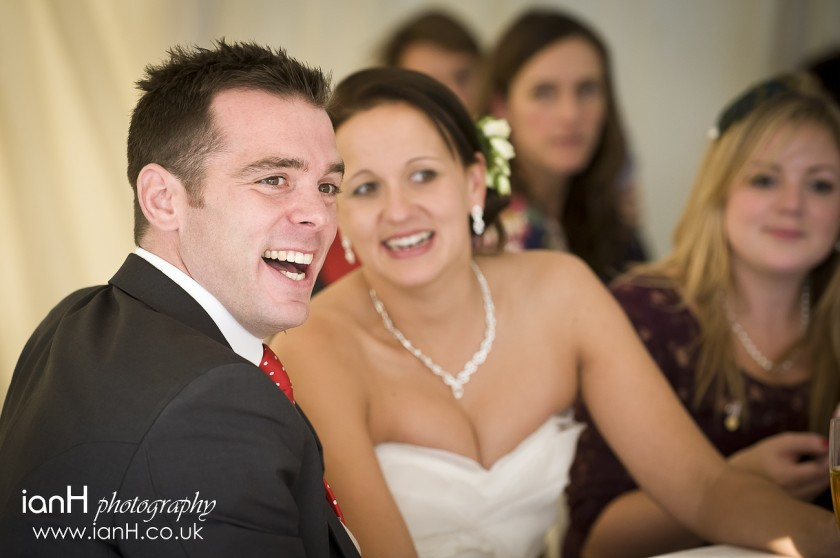 Bournemouth_wedding_photographer_Bride_and_Groom_laughing_during_the_wedding_speeches