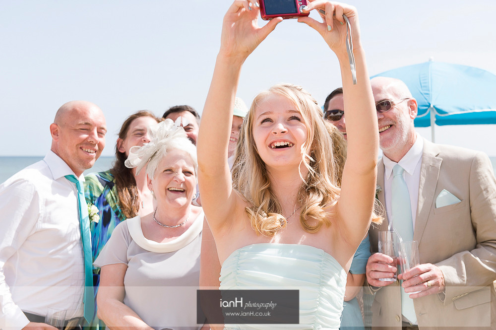 Family selfie at beach wedding in Bournemouth