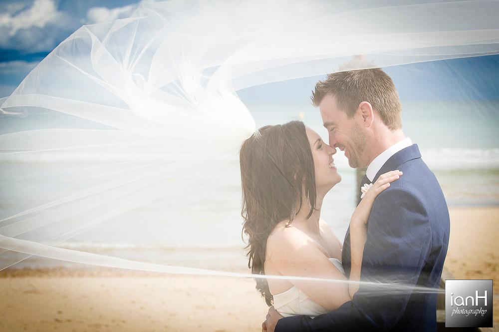 bournemouth-beach-weddings-bride-and-groom-behind-her-veil