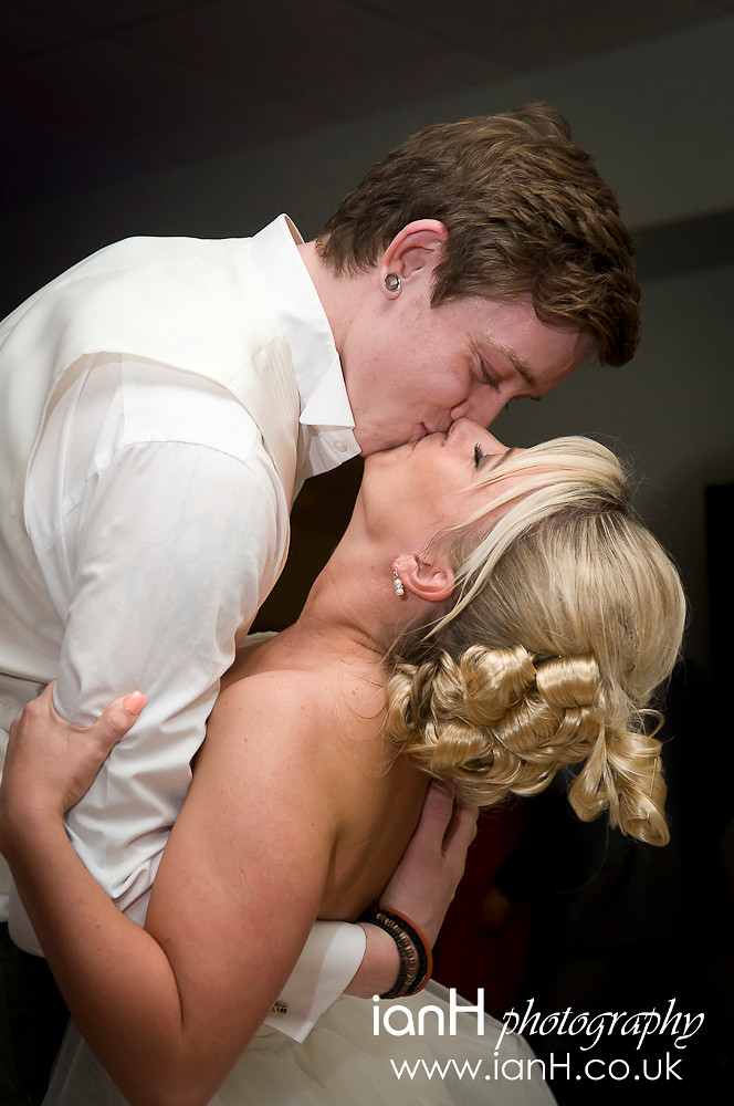 The_dip_as_the_Bride_and_Groom_have_their_First_Dance_at_their_wedding_reception_held_at_the_Piccadilly_Hotel_in_Bournemouth