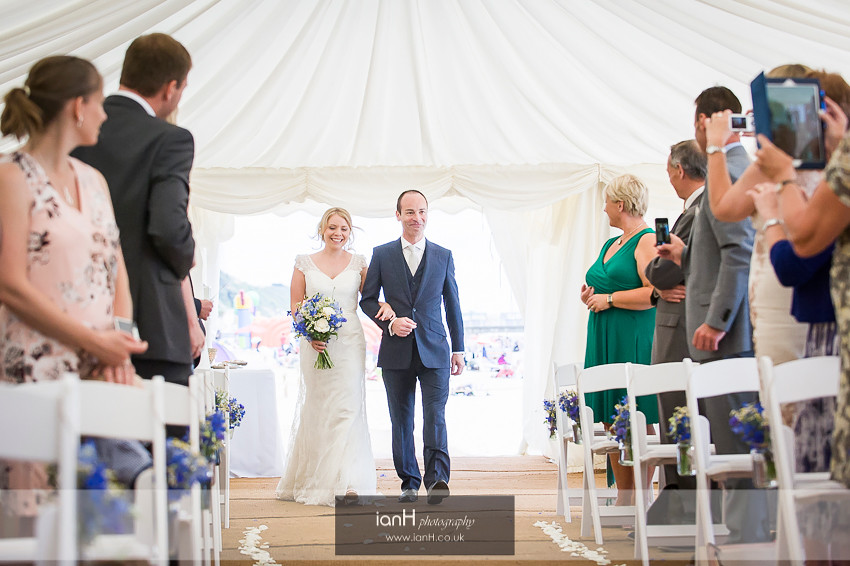 Bride and Father walk down aisle at Beach Weddings Bournemouth