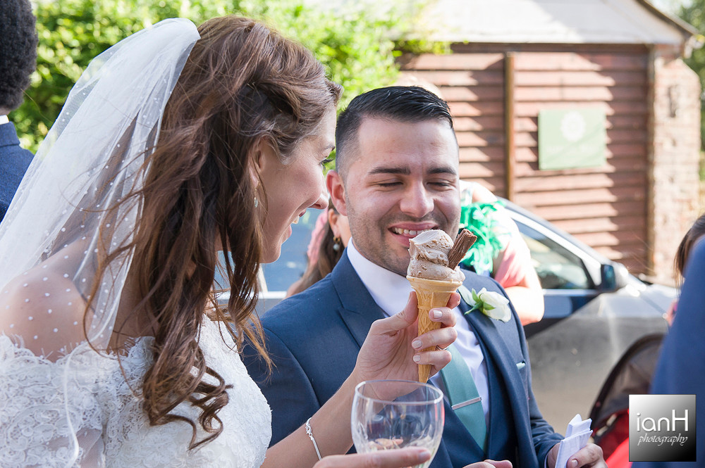 Bride with ice cream at Dorset wedding