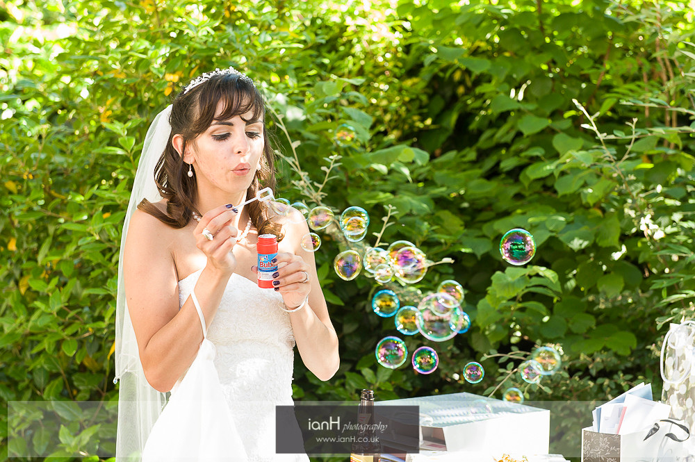Bride blowing bubbles at wedding Bournemouth