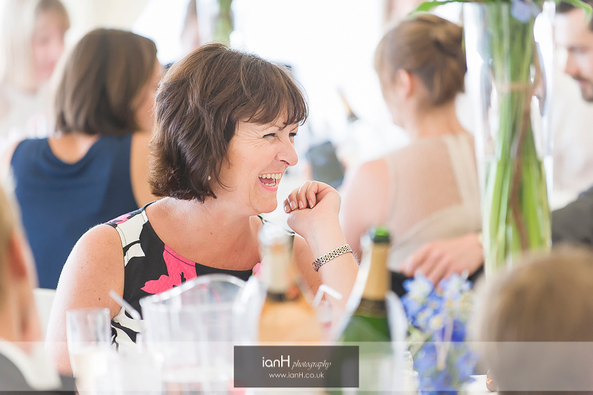 Laughing guest at Bournemouth beach wedding reception