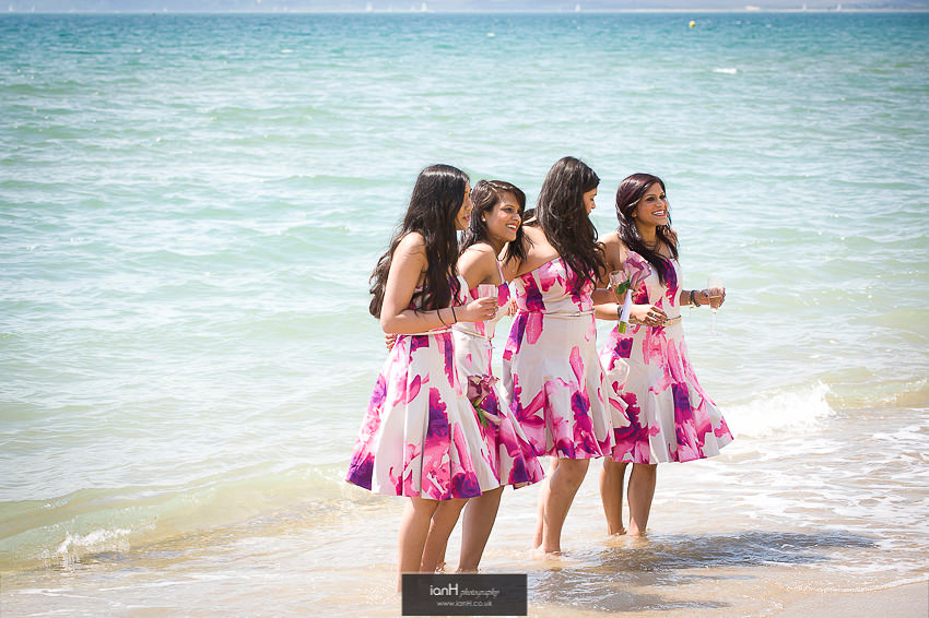 Bridesmaids in the sea at Bournemouth beach wedding