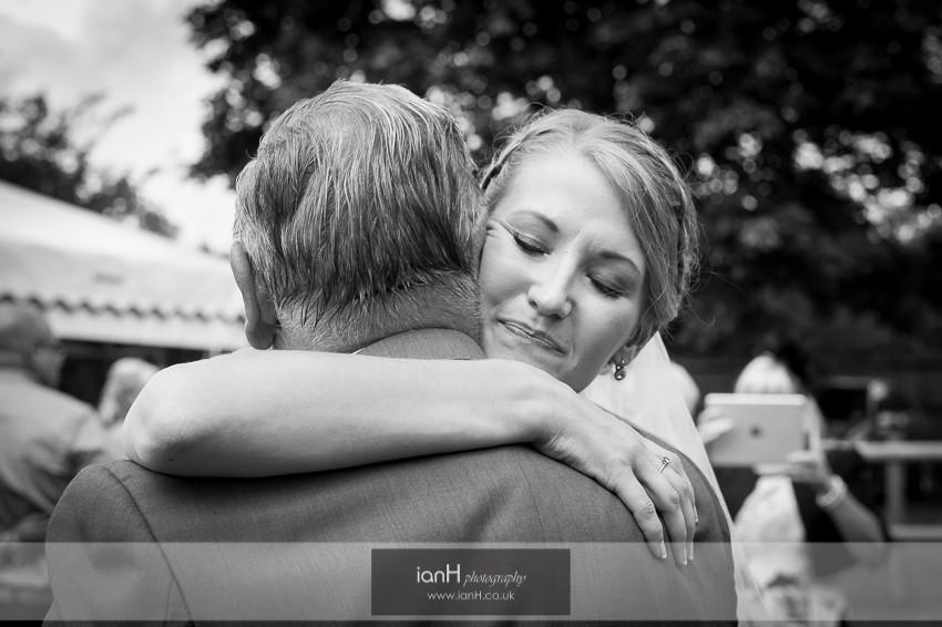 Bride hugging her GrandFather at her wedding