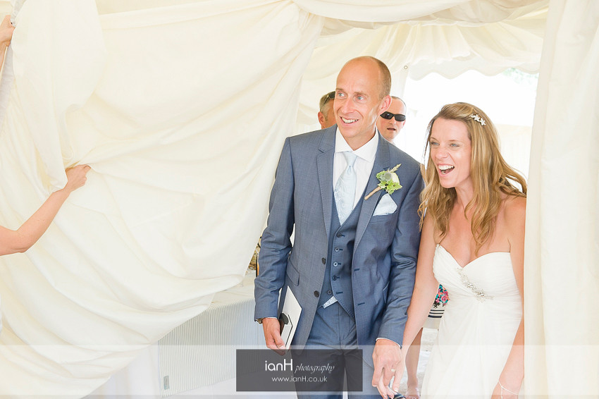 Bournemouth beach wedding Bride smiles as she sees her reception