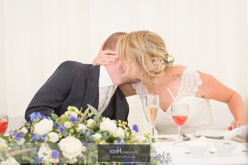 Bride and Groom kiss during the speeches