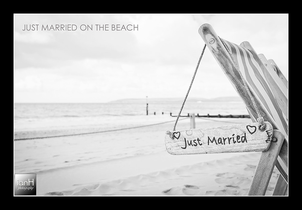 A just married sign hanging from a deckchair on Bournemouth beach