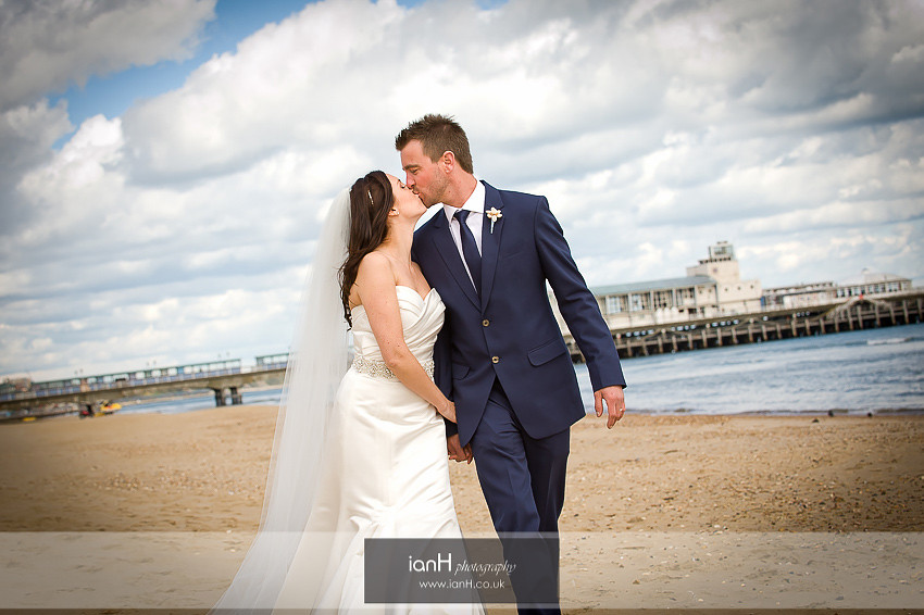 Bride and Groom kiss on Bournemouth beach