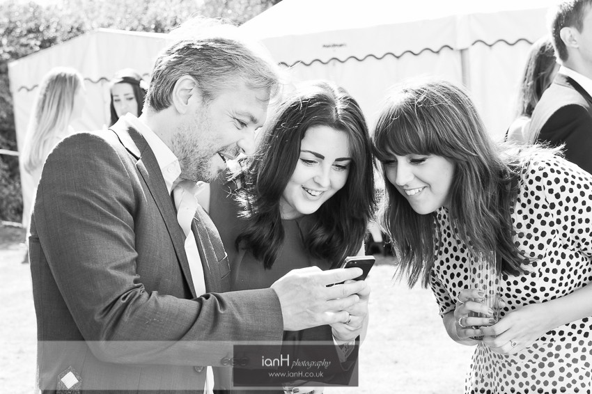 Wedding guests with iphones