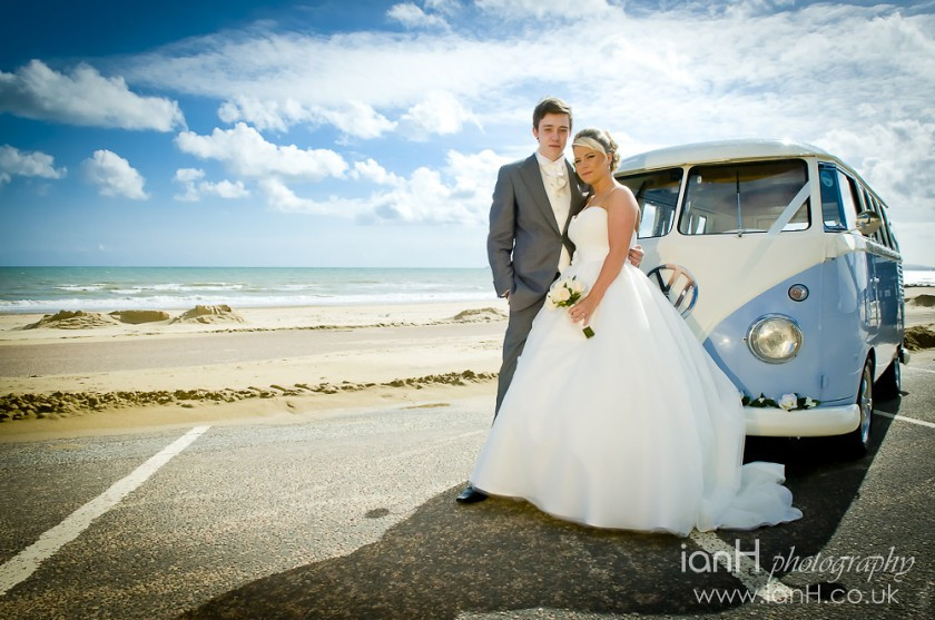 Bride_and_Groom_with_a_1960_split-screen_VW-camper_at_Boscombe_beach_after_their_wedding_in_Bournemouth_Town_Hall