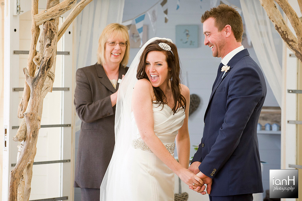 bournemouth-beach-weddings-bride-turns-and-smiles-at-her-parents