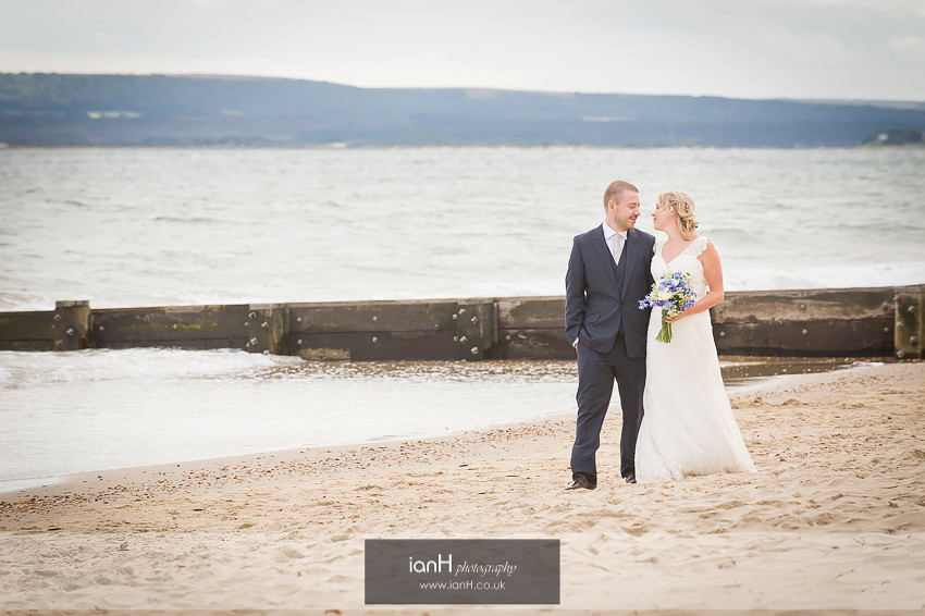 Bride and Groom strolling along Bournemouth beach