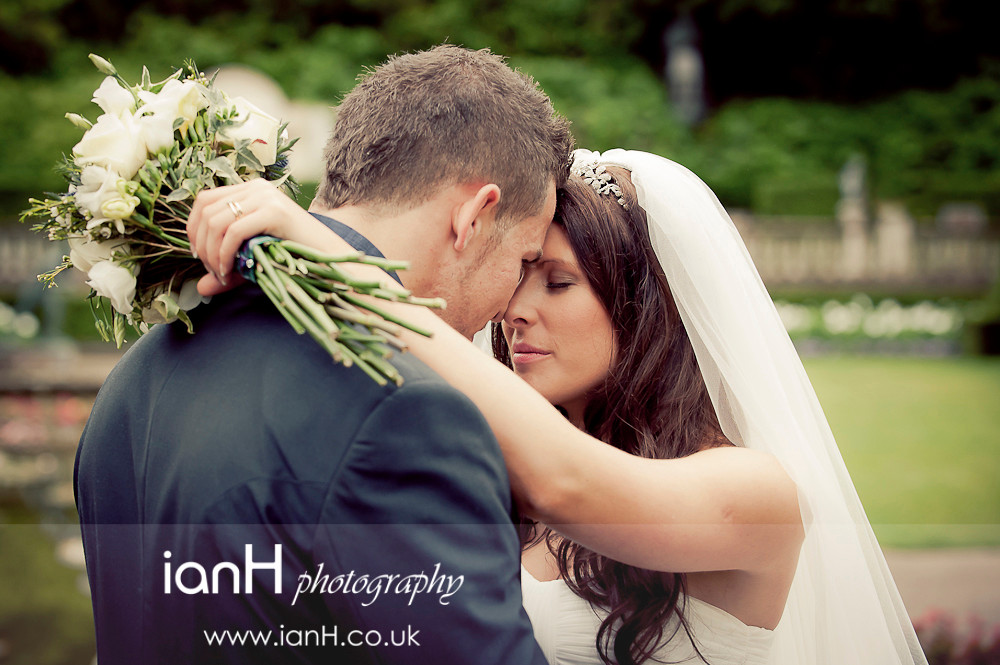 Bride_and_Groom_embrace_at_The_Italian_Villa_in_Poole_by_Dorset_wedding_photographer