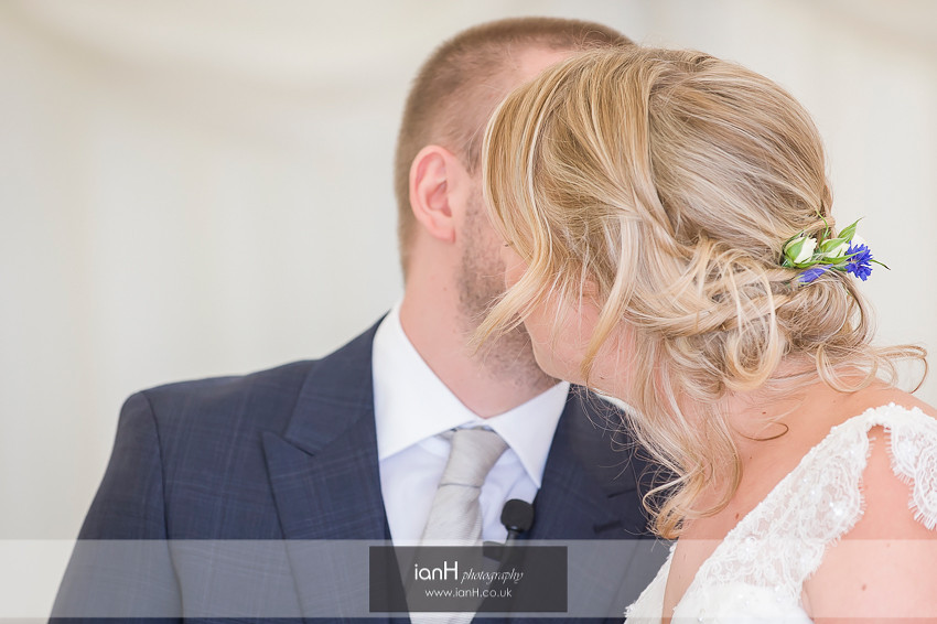 Groom kisses Bride at Bournemouth beach wedding