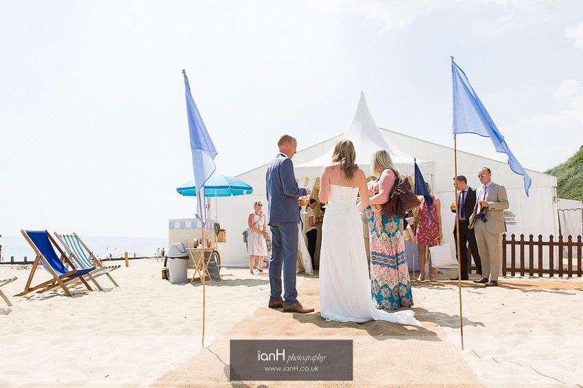 Beach wedding Bride and Groom in the sun