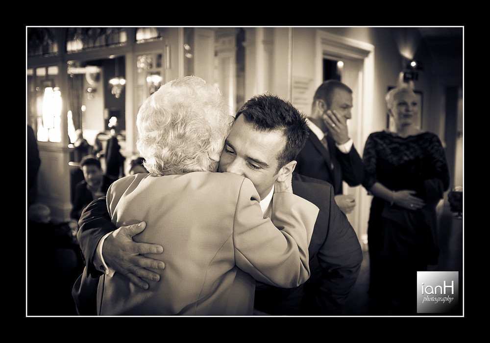 groom-hugs-grandmother-bournemouth-wedding-photographer-chine-hotel-bournemouth