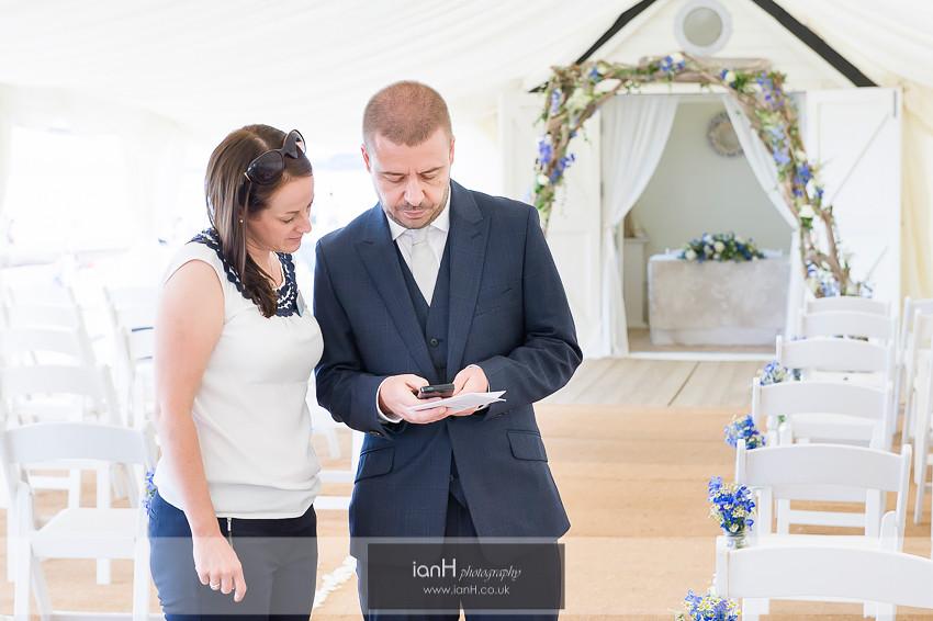 Groom checks his phone at Beach Weddings Bournemouth