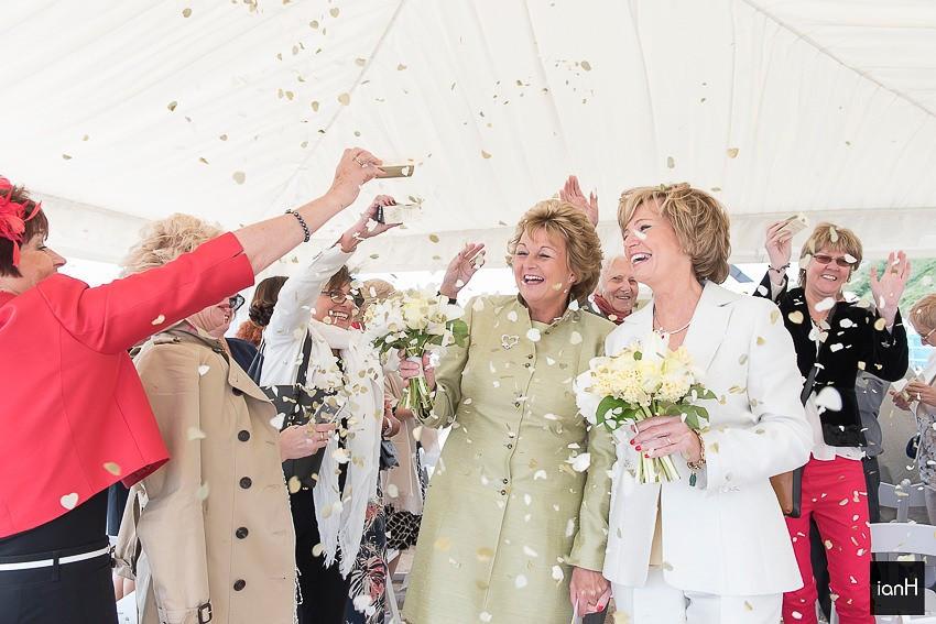 Confetti in the aisle at a beach wedding