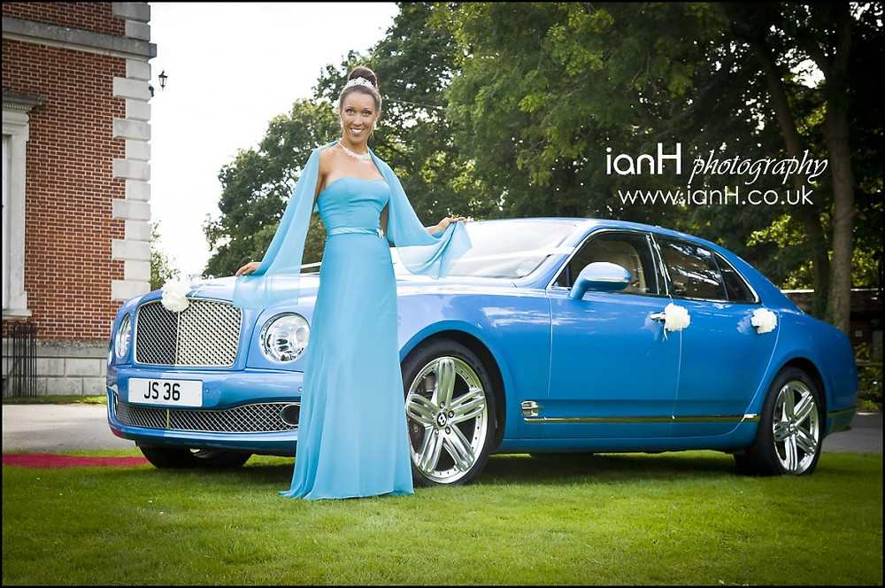Bride_poses_with_Bently_Mulsanne_at_Merley_House_Wimborne_by_Dorset_wedding_photographer