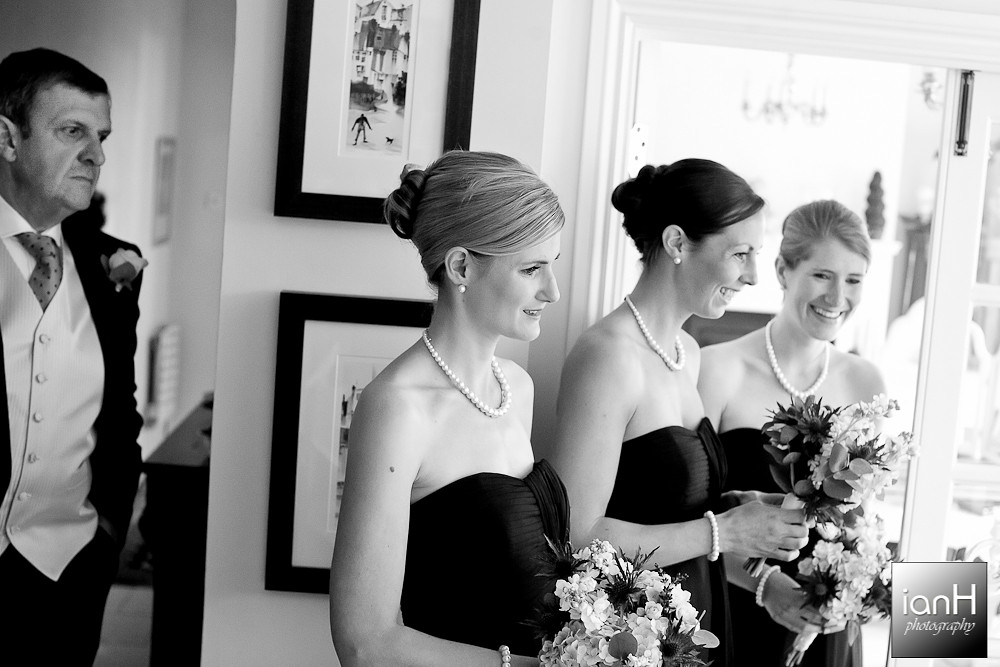new-forest-wedding-bridesmaids-smiling-at-the-bride-with-dad-looking-on