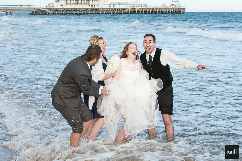 Bournemouth beach wedding Bridal party in sea