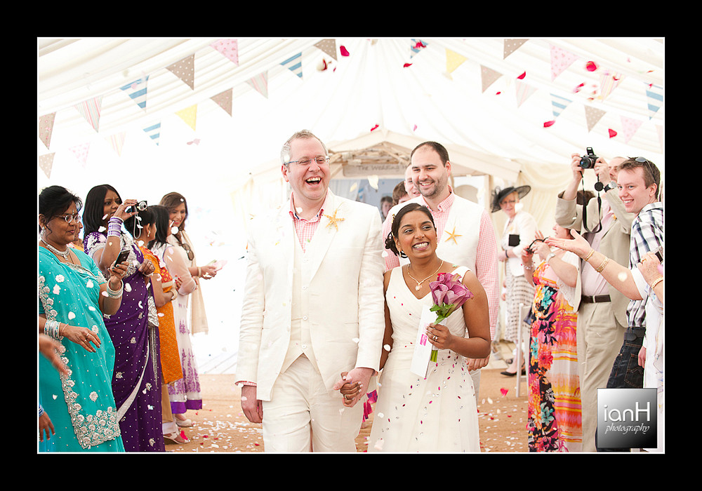 Happy-bride-and-groom-walking-down-the-aisle-at-beach-weddings-bournemouth