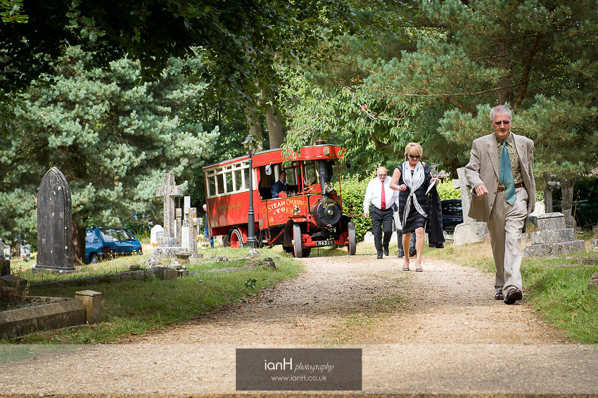 Bridal party arrives in a steam bus